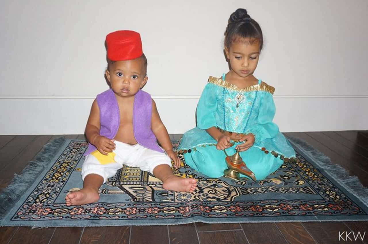 North and Saint West playing together on a run and dressed as Aladdin characters