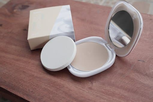 compact powder with mirror and sponge