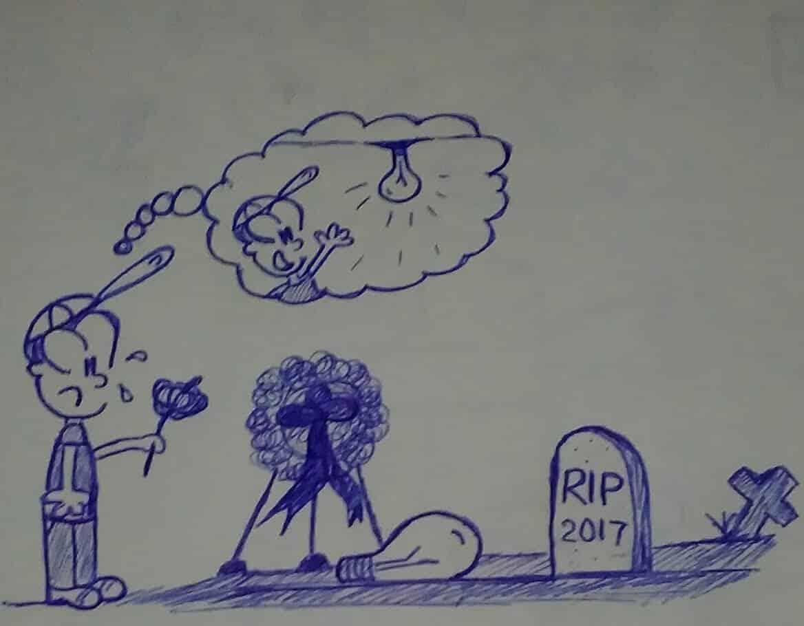 caricatura frente a una tumba