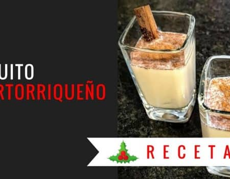 Coquito puertorriqueño in shot glasses decorated with cinnamon sticks