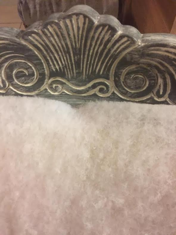 scroll detaiils in the wood of a vintage victorian arm chair