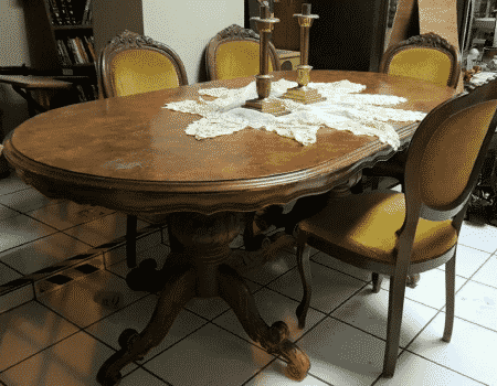vintage dining room table with five chairs