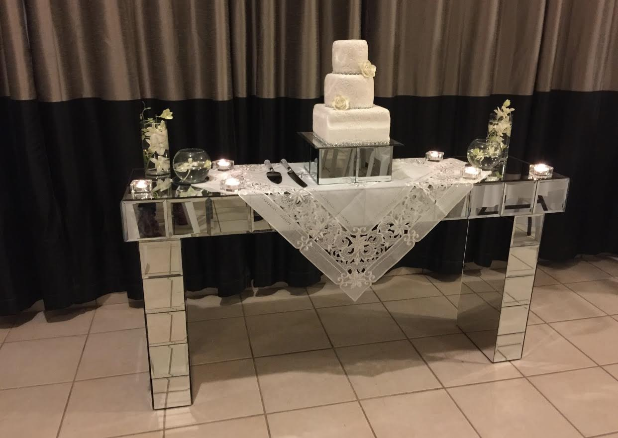 mirrored entryway with a cake on top of it
