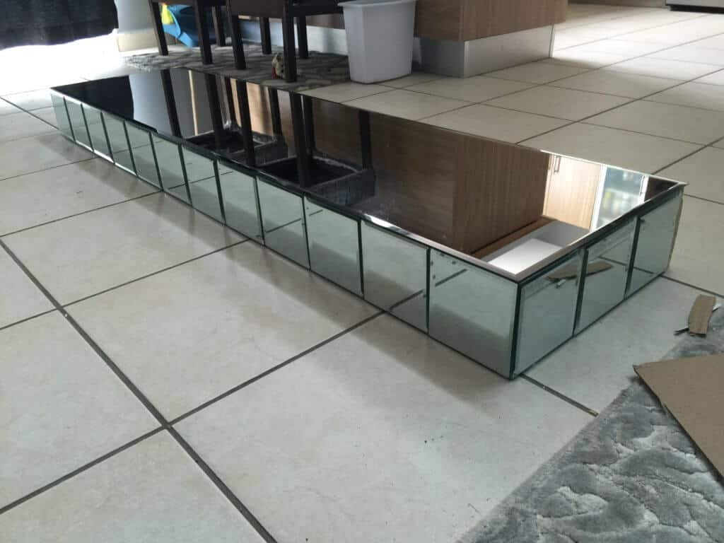 top for a diy mirrored entryway table fully covered in mirrors